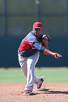 Enosil Tejeda #57 of the Cleveland Indians pitches during a Minor League Spring Training Game against the Cincinnati Reds at the Cincinnati Reds Spring Training Complex on March 25, 2014 in Goodyear, Arizona. (Larry Goren/Four Seam Images)