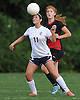 Alexa Shultz #11 of St. Dominic heads a ball away from Faith Dantona #11 of Long Island Lutheran during a varsity girls soccer game at Charles Wang Athletic Complex in Muttontown on Monday, Oct. 3, 2016. Shultz scored four goals to lead St. Dominic to a 6-4 win.