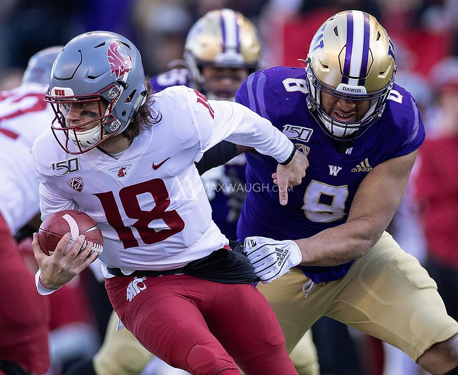 Benning Potoa'e slows down Cougar quarterback Anthony Gordon.