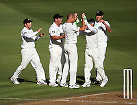 The Black Caps celebrate Chris Martin's dismissal of Rahul Dravid for 35 during day one of the 3rd test between the New Zealand Black Caps and India at Allied Prime Basin Reserve, Wellington, New Zealand on Friday, 3 April 2009. Photo: Dave Lintott / lintottphoto.co.nz
