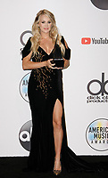 LOS ANGELES, CA - OCTOBER 09: Carrie Underwood, winner of the Favorite Female Artist - Country award poses in the press room during the 2018 American Music Awards at Microsoft Theater on October 9, 2018 in Los Angeles, California. <br /> CAP/MPI/IS<br /> &copy;IS/MPI/Capital Pictures