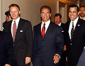 Washington, DC - October 29, 2009 -- California Governor-elect Arnold Schwarzenegger arrives in the United States Capitol in Washington, DC on October 29, 2003.  He was meeting with the U.S. House Republican Conference to discuss ways to bring more money to California to help eliminate its financial crisis. Left to right: U.S. Representative David Dreier (Republican of the 26th District of California), Governor-elect Schwarzenegger, and U.S. Representative Darrell Issa (Republican of the 49th District of California).Credit: Ron Sachs / CNP