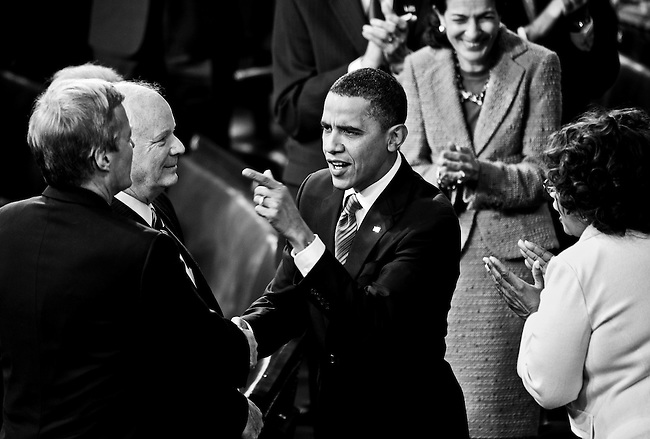 President Barack Obama speaks with Sen. Max Baucus, D-Mont., left, and Sen. Ben Cardin as he arrives to deliver his first State of the Union Address on Jan. 27, 2010.
