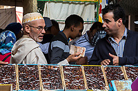 Rissani, Morocco.  Customer Buying Dates in the Market.