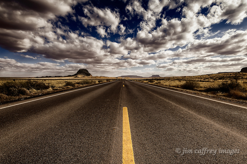 Indian Route 6 as it approaches Round Butte on the Hopi Reservation in northeastern Arizona.