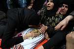 Relatives of Palestinian Hasan Nofal 17, who was died of his wounds which he sustained by Israeli forces during clashes in tents protest where Palestinians demand the right to return to their homeland at the Israel-Gaza border, mourn over his body during his funeral at al-Bureij in the central of Gaza Strip on February 13, 2019. Photo by Ashraf Amra