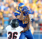 BROOKINGS, SD - SEPTEMBER 12:  Jake Wieneke #19 from South Dakota State catches a pass over the top of LeShawn Sims #36 from Southern Utah in the first half of their game Saturday night in Brookings. (Photo by Dave Eggen/Inertia)