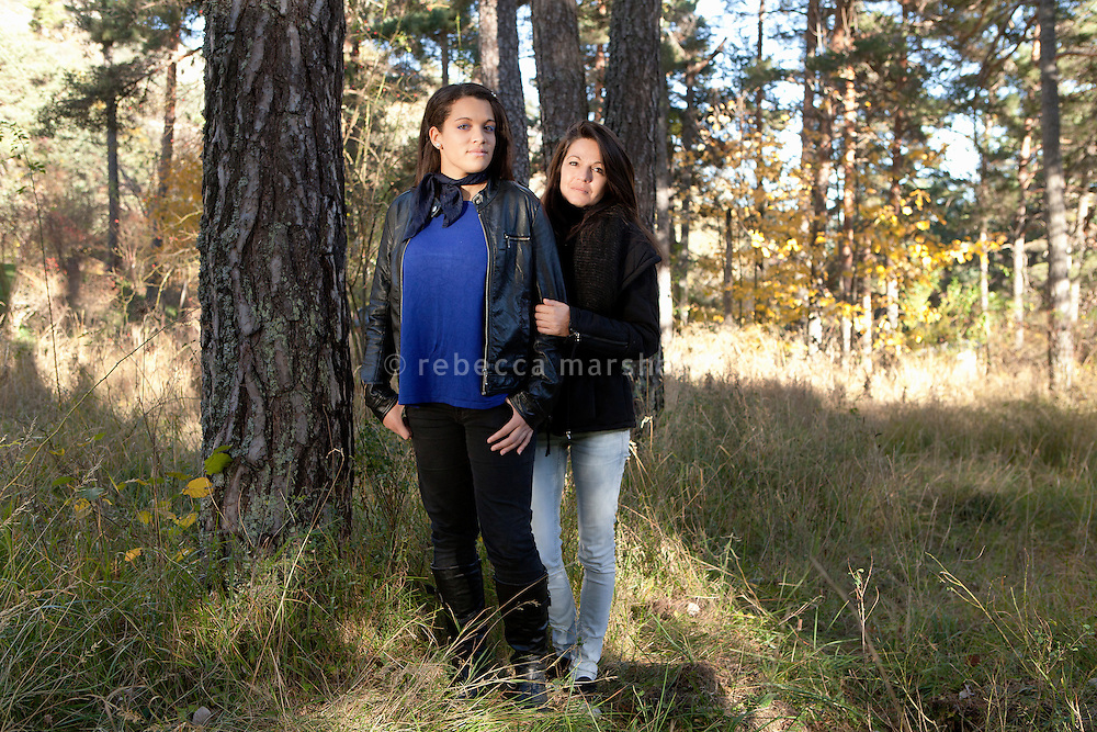 Sophie Serrano (right) and her daughter Manon, 19 years old, pose for the photographer in the woods below their apartment block, Thorenc, France, 11 November 2013. When Manon was 10 years old, DNA tests showed that Sophie was not her biological mother - just as her father, who had left Sophie when Manon was 3 years old, suspecting that he was not Manon's true father, was indeed not her biological father. It was discovered that Sophie's baby had been exchanged with another in the maternity clinic, 5 days after birth. Both children live today with the families that raised them.