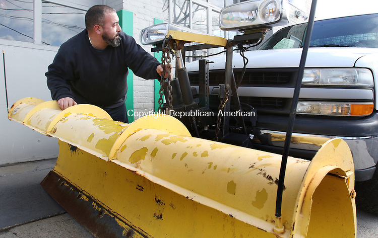 WATERBURY CT. 28 December 2015-122815SV02-Marco Deriu of M.A.D. Services in Waterbury readies his plow for the upcoming storm on Baldwin Street in Waterbury Monday. <br /> Steven Valenti Republican-American