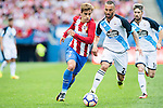 Antoine Griezmann of Atletico Madrid fights for the ball with Jonathan Rodríguez of Deportivo de la Coruna during their La Liga match between Atletico Madrid and Deportivo de la Coruna at the Vicente Calderon Stadium on 25 September 2016 in Madrid, Spain. Photo by Diego Gonzalez Souto / Power Sport Images