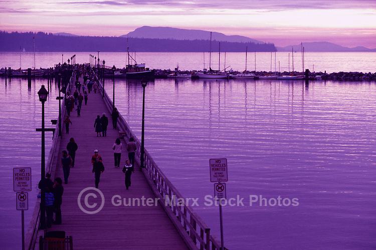 White Rock, BC, British Columbia, Canada - People walking on White Rock Pier along Semiahmoo Bay