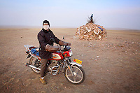 A farmer on his motorbike on the Xilamuren grasslands that dominate the north of the Inner Mongolian capital, Hohhot.
