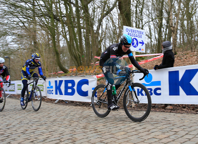 Riders including Gabriel Rasch (Sky Procycling) climb Kemmelberg for the first time during the 75th edition of Gent-Wevelgem, Belgium, 24th  March 2013 (Photo by Eoin Clarke 2013)