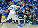 March 1, 2016 - Colorado Springs, Colorado, U.S. -   Utah State forward, Lew Evans #12, pulls up along the sideline against Falcon center, Frank Toohey #33, during an NCAA basketball game between the Utah State University Aggies and the Air Force Academy Falcons at Clune Arena, United States Air Force Academy, Colorado Springs, Colorado.  Utah State defeats Air Force 78-65.