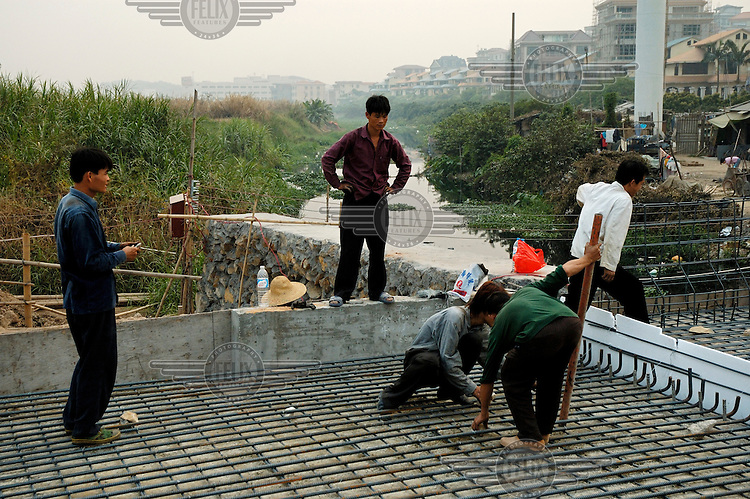 Migrant labourers at work on a highway construction project.