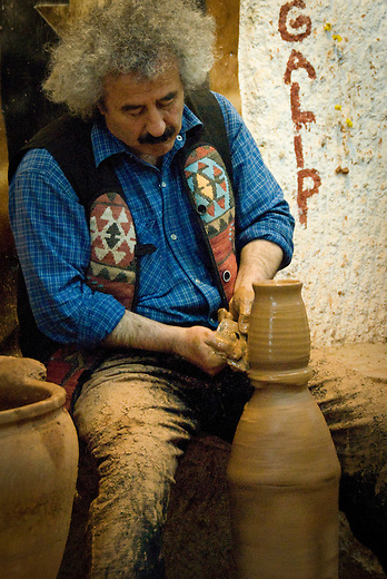 Galip Körükçü hard at work creating pottery at his Avanos studio and shop, Chez Galip, one of the town's oldest pottery studios. Local craftsmen have made red-clay pottery for thousands of years in this area.