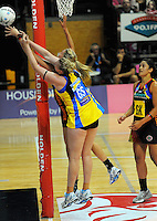 Magic goalkeep Casey Williams competes for the ball with Caitlin Thwaites. ANZ Netball Championship - Central Pulse v Bay Of Plenty-Waikato Magic at TSB Bank Arena, Wellington, New Zealand on Monday, 28 February 2011. Photo: Dave Lintott / lintottphoto.co.nz