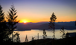 Idaho, North, Bonner County, Priest Lake. Sunset over the Selkirk Range and Priest Lake in North Idaho.
