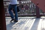 Man in jeans walking on the La Salle Street Bridge over the Chicago River, Chicago, IL, USA