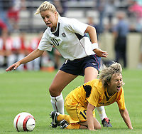 10 July 2005:   Aly Wagner of USA fights for the ball against Ukraine defender during the first half of the game at Merlo Field at University of Portland in Portland, Oregon.    USA defeated Ukraine, 7-0.   Credit: Michael Pimentel / ISI