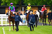 Winner of The Wilton Homes Novice Stakes Tapisserie ridden by Ryan Moore and trained by William Haggas is led into the Winners Enclosure during Evening Racing at Salisbury Racecourse on 11th June 2019