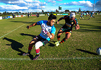 TJ Vaega (Grammar, left) and Niukula Osika chase the ball the Auckland Premier club rugby Alan McEvoy Trophy match between Pakuranga and Grammar TEC at Bell Park in Auckland, New Zealand on Saturday, 9 June 2018. Photo: Dave Lintott / lintottphoto.co.nz