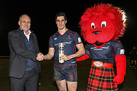 Ross Neal of London Scottish (centre) receive the man of the match award after the Greene King IPA Championship match between London Scottish Football Club and Jersey Reds at Richmond Athletic Ground, Richmond, United Kingdom on 16 March 2018. Photo by David Horn.