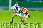 Kerins O'Rahillys Gavin O'Brien gets a pull of the jersey from Evan Cronin of East Kerry in the County Football Championship 3rd round game on Saturday.