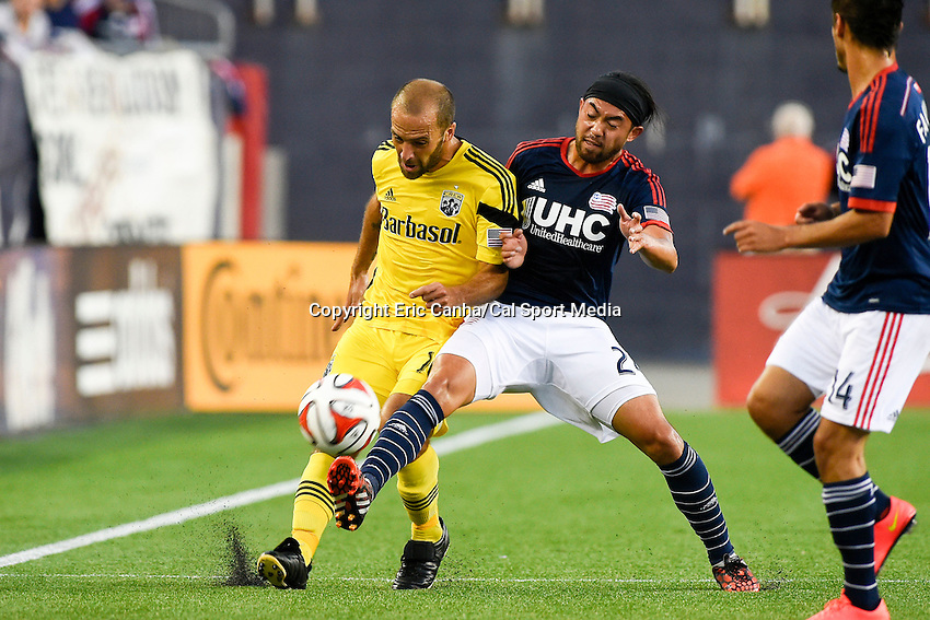 July 26, 2014 - Foxborough, Massachusetts, U.S. - Columbus Crew forward Federico Higuain (10) and New England Revolution midfielder Lee Nguyen (24) work for the ball during the MLS game between the Columbus Crew and the New England Revolution held at Gillette Stadium in Foxborough Massachusetts.  Eric Canha/CSM