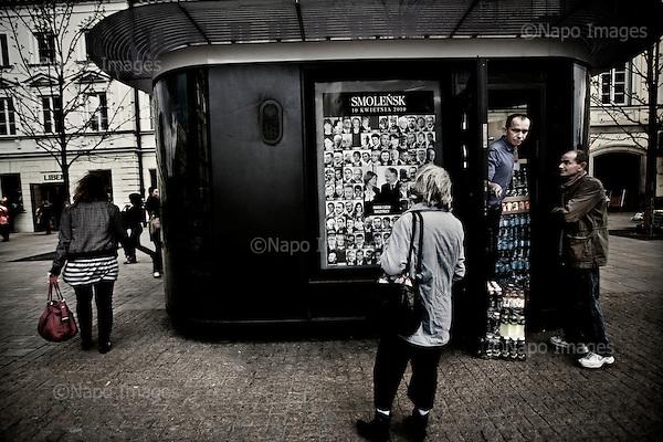 Warsaw 12/04/2010 Poland<br /> People mourning the tragic death of President Lech Kaczynski and his wife.<br /> on pictures: a poster with pictures of all the victims of the tragedy in Smolensk.<br /> Photo: Adam Lach / Napo Images for The New York Times<br /> <br /> Zaloba po tragicznej smierci Prezydenta Lecha Kaczynskiego i jego malzonki.<br /> na zdjeciu: plakat ze zdjeciami wszystkich ofiar tragedii w Smolensku<br /> Fot: Adam Lach / Napo Images for The New York Times