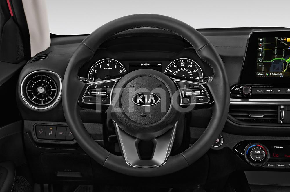Car pictures of steering wheel view of a 2019 KIA Forte EX 4 Door Sedan