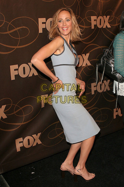 KIM RAVER.FOX January 2006 TCA Party held at Citizen Smith, Hollywood, California..January 17th, 2006.Photo: Zach Lipp/AdMedia/Capital Pictures.Ref: ZL/ADM.full length blue sleeveless dress crouching.www.capitalpictures.com.sales@capitalpictures.com.© Capital Pictures.