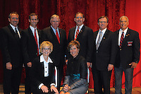 NWA Democrat Gazette/JOCELYN MURPHY<br /> Marty Burlsworth (from left), Sam Sicard, honoree Judy McReynolds, Robert Young III, Cathy Gates, John Boozman, Curt Bradbury and Ralph Garcia and pose at the seventh annual Brandon Burlsworth Legends Dinner, hosted at the Fort Smith Convention Center on Friday, Oct. 20, 2016.