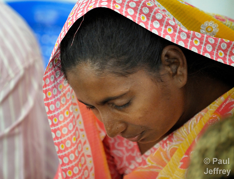 M. Jothi prays during the meeting of a support group for HIV positive people at the Gurukul  Lutheran Theological College in Chennai, India. (Note restrictions on use in Special Instructions below.)