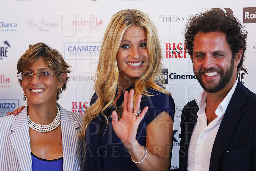 From left, Giulia Buongiorno, Michelle Hunziker and Gabriele Pignotta attend a photocall for the movie 'Ancora un'Altra Storia' during the 72nd Venice Film Festival at the Palazzo Del Cinema in Venice, Italy, September 7, 2015.<br /> UPDATE IMAGES PRESS/Stephen Richie