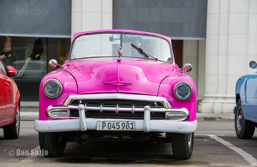 Havana, Cuba - A taxi waits for fares near Parque Central. Classic American cars from the 1950s, imported before the U.S. embargo, are commonly used as taxis in Havana.