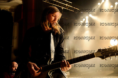 Band of Skulls - vocalist and guitarist Russell Marsden - performing live at the Empire in Shepherds Bush London UK - 27 Mar 2014.  Photo credit: George Chin/IconicPix