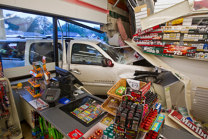 "The entire front counter of the 7-11 on Rt. 71 was destroyed when a Chevy Suburban came careening through the front wall and windows at about 6:15 pm Friday.  ""I heard a big bang and I just ran,"" the 7-11 clerk said, who said he only suffered a minor leg injury.  The driver was extricated and transported by members of the Manasquan fire department and first aid squad.  6/7/13 photo by Andrew Mills"