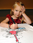 Hannah Klein,4, of Tomball colors a tee shirt at the Houston Symphony League's annual Magical Musical Morning event at the Houstonian Saturday Dec. 12,2009.(Dave Rossman/For the Chronicle)