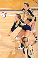 11 September 2011:  FIU defensive specialist/libero Carolyn Fouts (17) keeps the ball in play as defensive specialist Rachel Fernandez (5) watches in the second set as the FIU Golden Panthers defeated the Florida A&M University Rattlers, 3-0 (25-10, 25-23, 26-24), at U.S Century Bank Arena in Miami, Florida.