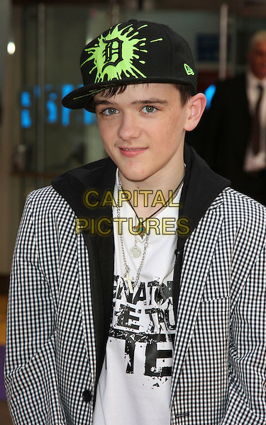 """GEORGE SAMPSON .UK Premiere of """"Hannah Montana: The Movie"""" at the Odeon Leicester Square, London, England, UK, April 23rd 2009.half length jacket cap hat  green fluorescent gingham checked blazer arms folded  black hoodie necklace .CAP/ROS.©Steve Ross/Capital Pictures"""