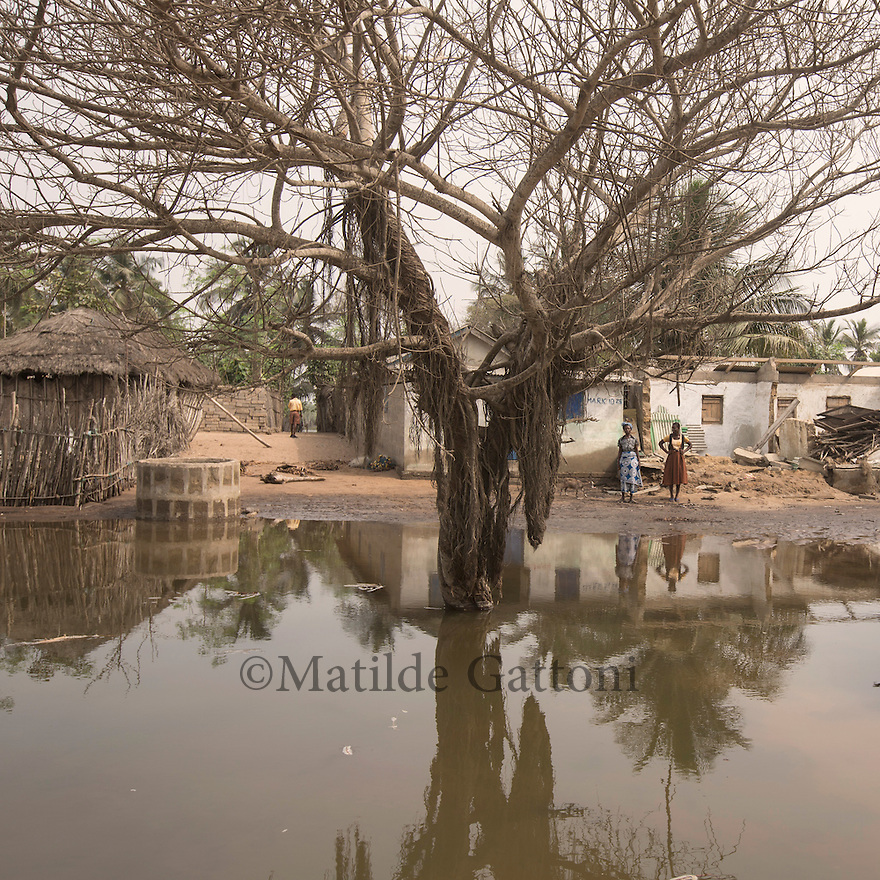 Ghana - Fuveme - The village flooded during high tide. Nestled between the ocean and the Volta river estuary, the village of Fuvemeh has seen its territory reduced from several kilometers to few hundred meters. Nowadays, the villages sits on a narrow strip of land which separates the coastline from the adjacent lagoon. Haunted by coastal erosion, its 1,000 inhabitants have literally nowhere to move.