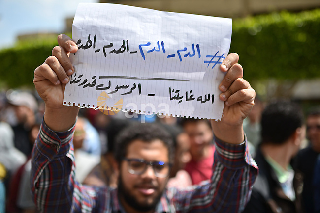 """Egyptian students who support Muslim Brotherhood and ousted president Mohammed morsi hold banners and shout slogans during a protest in solidarity with Syrian people, at Cairo University on April 1, 2015. International donors meeting in Kuwait City have pledged $3.8bn to help alleviate war-torn Syria's humanitarian crisis,  which Kuwait's emir warned was the worst in """"modern history"""". Photo by Amr Sayed"""
