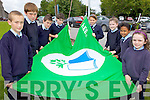 RUN IT UP THE POLE: The Green Flag committee at St Oliver's national school in Ballylongford unfurl their new green flag on Friday. Included are: Emer Walsh, Leah Flahive, Conor Carmody, Sophie Parish, Cian Barrett, Clodagh Swanser, Eoin O'Connor and James O'Connor..