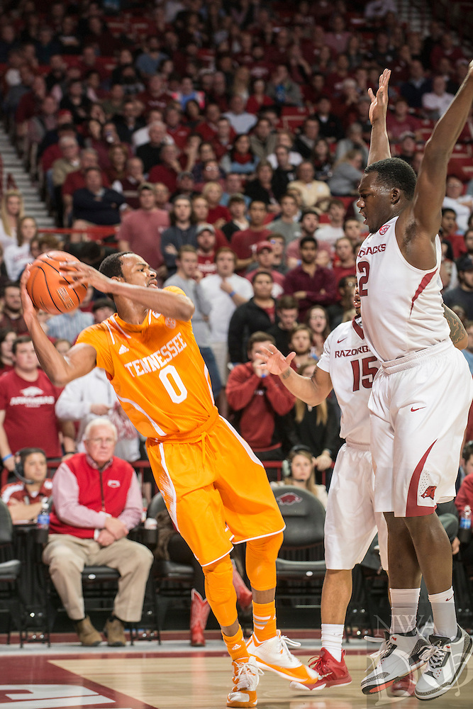 NWA Democrat-Gazette/ANTHONY REYES • @NWATONYR<br /> Alandise Harris, Arkansas senior, defends Kevin Punter, Tennessee junior, in the second half Tuesday, Jan. 27, 2015 at Bud Walton Arena in Fayetteville. The Razorbacks won 69-64.