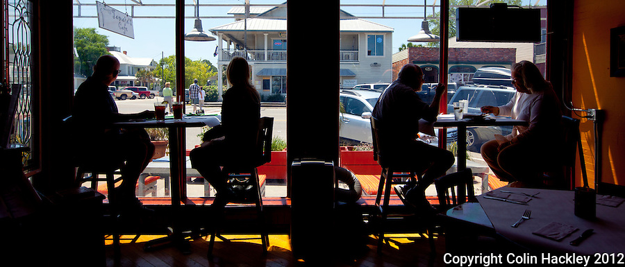 Diners inside Tamara's Cafe observe the scene in downtown Apalachicola...COLIN HACKLEY PHOTO