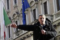 Roma, 12 Dicembre 2013<br /> Manifestazione per la difesa del lavoro.<br /> Maurizio Landini segretario generale della FIOM sale su una automobile davanti Palazzo Chigi per un comizio dopo l'incintro con il Governo
