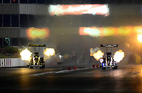 May 18, 2012; Topeka, KS, USA: NHRA top fuel dragster driver Antron Brown (right) races alongside Morgan Lucas during qualifying for the Summer Nationals at Heartland Park Topeka. Mandatory Credit: Mark J. Rebilas-