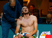 Rotterdam, The Netherlands, 11 Februari 2020, ABNAMRO World Tennis Tournament, Ahoy, <br /> Stefanos Tsitsipas (GRE), is treated for a injury and suffers pain<br /> Photo: www.tennisimages.com