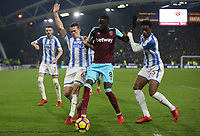 West Ham United's Cheikhou Kouyate gets in between Huddersfield Town's Jonathan Hogg and Terence Kongolo<br /> <br /> Photographer Rob Newell/CameraSport<br /> <br /> The Premier League - Huddersfield Town v West Ham United - Saturday 13th January 2018 - John Smith's Stadium - Huddersfield<br /> <br /> World Copyright &copy; 2018 CameraSport. All rights reserved. 43 Linden Ave. Countesthorpe. Leicester. England. LE8 5PG - Tel: +44 (0) 116 277 4147 - admin@camerasport.com - www.camerasport.com